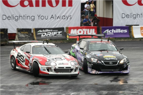 Daigo Saito(chase car) battles Manabu (Max)  Orido in the      Achilles Formula Drift Malaysia 2012 finals